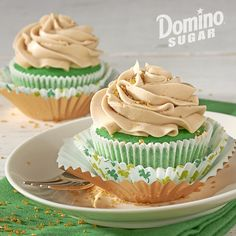 Irish Cream Cupcakes  | With a swirl of Irish Cream frosting and a dusting of gold sprinkles, this recipe is pure magic