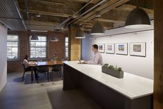 Workplace design featuring large gathering space for meals, informal meetings and socializing. Designed by BH+A.