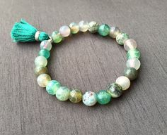 A handmade green bohemian style Agate Stretch Bracelet perfect for layering with other bracelet favorites; 7 inches.($25)