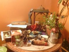 pixiesnakes:    Roommate gave me a nice shrine for all my murtis though my lemon balm still dominates the whole altar. There's actually Brit trad witchcraft and curanderismo stuff hidden in there too!
