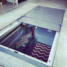 One of our recent customers out of Owasso, Oklahoma has some serious decorating skills. Check out her fully furnished underground garage storm shelter! You could almost live in there. Storm Shelters of Tulsa Stay Alive, Call Underground Storm Shelters, Underground Garage, Hidden Spaces, Hidden Rooms, Tornado Safe Room, Casa Bunker, Storm Cellar, Panic Rooms, Casas Containers