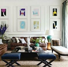 via elle decor  I like layout not really the couches  Like the formation of the art
