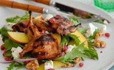 Marinated quail salad with peach, fetta and pomegranate seeds