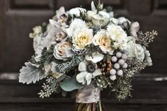 winter wedding flowers - there is something so lovely about an all white winter boquet