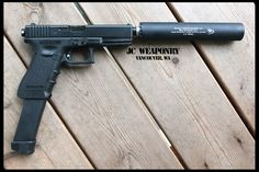 My favourite handgun the Silenced G18 with Extended Mags. A favourite with the Special Forces. ;)    The G18 (Glock 18) is a full-automatic varient of the G17C. It is an Austrian made pistol which was first produced in 1982. It fires the 9x19mm cartridge, effective at close range.