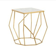 The octagonal base of this unique, modern side table connects free-form angled bars of gold-leafed iron to a white marble slab top. Marble will vary. Adds drama to any living room. Finish : Gold Leaf