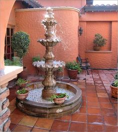Mexican fountain and beautiful satillo tile courtyard. I love tile and fountains, would be perfect for my dream home. Mexican Courtyard, Spanish Courtyard, Mexican Hacienda, Mexican Style, Mexican Patio, Spanish Patio, Mexican Garden, Spanish Revival, Spanish Style Homes