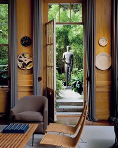 the London apartment of Sting and Trudie Styler, restored by Anthony Close-Smith, featuring Mimmo Paladino's Untitled standing bronze…