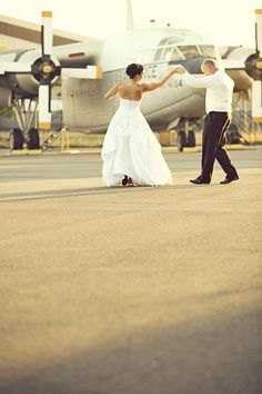 dancing in front of plane photo st0228-F1280x1024 by The Bluest Muse, via Flickr