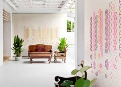 Tripasai Architect have designed the entrance lobby of a private residence in Bangkok, Thailand, that features an embroidered flower petal backdrop wall.