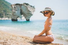 darya kamalova thecablook fashion lifestyle blogger from thecablook com in baia dei faraglioni in puglia south italy wearing river island kisses bikini and straw hat-3376