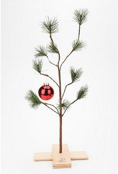 I so want one of these!  Watching Charlie Brown Christmas special has become a Christmas tradition for our family and this little tree represents humility to me... love it!