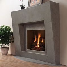 Who says cast stone has to just have a classic look, this fireplace would fit perfectly in a modern space!