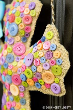 Brighten up your front door with pretty Easter decor! Simply create a pillow cross out of burlap and hot glue buttons to the top layer.