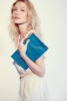 Try a blue envelope clutch. (Sealed with a kiss, of course.)