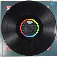 Vinyl Record - played on a turntable with a needle that rode in the grooves to make the sound.