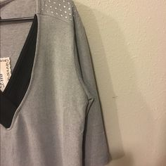 Soft Gray Sweater with Black Detail and Gems Three quarter length sweater that is cozy and perfect for fall and winter. Black details around the neckline and gemstones in the shoulder make it extra adorable. 95% Polyester. 5% Spandex. Price is firm unless bundled. Boutique Sweaters V-Necks