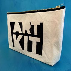 """Art Kit Zippered Canvas Bag - 11""""x7""""    Hand stamped with the Art Kit linocut on an antique book press, this sturdy canvas bag fitted with a durable metal zipper is great for pencils, markers, paintbrushes, stickers, even make up and hair accessories!"""