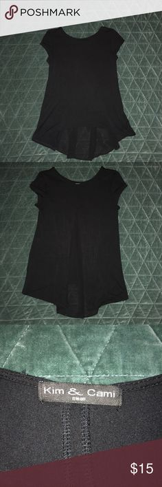 Black short sleeve tunic top. Size small. Black tunic top. Back accented with chiffon inlay. Tops