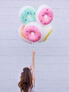 We've never before had an urge to lick a balloon, but there's a first time for everything, right? These inflatable doughnuts from DIY Studio...
