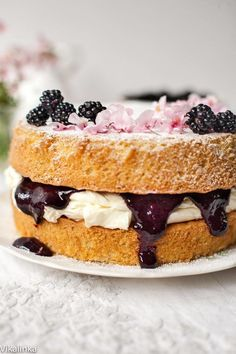 Classic British dessert Victoria Sponge Cake with mascarpone cream and wild blackberry compote. Classic Victoria Sponge has jam and caster sugar only. What you've made is plain cake with disgusting gloop inside. Mary Berry would weep. Menu Desserts, Just Desserts, Delicious Desserts, British Desserts, Baking Recipes, Cake Recipes, Top Recipes, Victoria Sponge Cake, Gateaux Cake