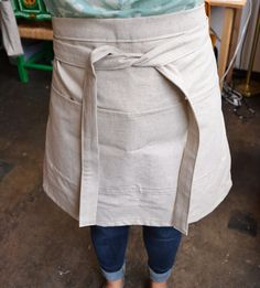 Linen Half Apron - #DIY #Sewing #Tutorial from the Atlanta Institute of Stitches and Crafts. Fun project that requires very little fabric for a gift giving or a fresh accessory for your kitchen.