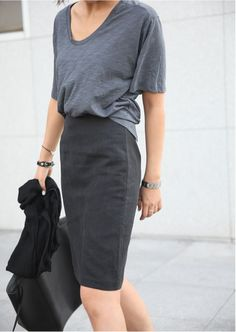 Shades of grey. Tuck in a loose fit solid color tee into a tailored solid colored pencil skirt for a comfortable, stylish, and professional business look.