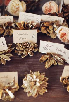 Brides.com: . Gold succulent escort card holders are gorgeous and glamorous, livening up the plain paper they hold. Copy the look yourself by spraying real or fake succulents with gold paint.