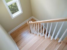 Hardwood stairs with a landing provide for safe, easy movement from one level to another. Staircase Banister Ideas, Staircase Makeover, Staircase Design, Staircases, Banisters, Oak Stairs, Wooden Stairs, Hardwood Stairs, Basement Stairs