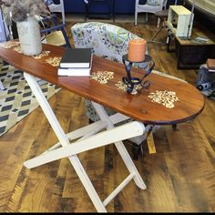 This is an old wooden ironing board that was given to us by a dear friend. My wife stenciled the ironing board and then stained & poly-ed the top. She painted the legs and lightly distressed them giving this vintage piece a new life! For sale and on display at Lynthia Designs.