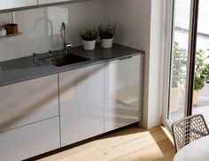SANTOS kitchen   The totally integrated dishwasher is a clear example that proves it is possible to achieve maximum functionality without forgetting aesthetics.