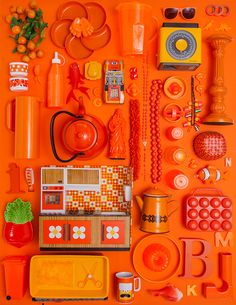 Set Design of various objects ordered by color range.