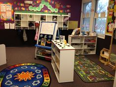 Preschool classroom. catapillar. hungry to learn I like the use of shelves to block of an area, helps define the area an gives storage space as well.