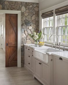 Interior Design Kitchen Farmhouse sink with white painted cabinetry set against cobbled stone wall. Design by Patrick Ahearn Architect - See why we're dying over this natural trend! Kitchen Interior, House Design, Home, Kitchen Remodel, Kitchen Decor, New Homes, Home Kitchens, Kitchen Design, Rustic House