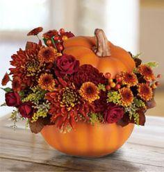 Halloween Flower Arrangements In Ceramic Pumpkins (3 ideas) - could use foam pumpkins from craft stores