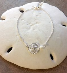"A Sand Dollar Pearl Drop Anklet is both stylish and fun. A Mermaid's Fashion Jewelry. Please see other listings for our Mermaid or Seahorse Pearl drop Anklet. Material: Base Metal Size: Adjustable 9""-"