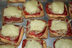 Miniature Reuben Appetizers  1 loaf cocktail rye bread  1 bt. Thousand Island Drsg  3/4 # corned beef or pastrami thin  1 can sauerkraut, drained  3/4 # Swiss cheese, sliced thin, cut in 1/4  Place bread slices on ungreased  cookie sheet. Spread breads with  dressing, add slice of corned beef or pastrami, folded to fit bread, add 1 T. of sauerkraut, then sq. of  Swiss cheese  Bake at 350º  for 10-12 min. til cheese is  melted best warm from the oven