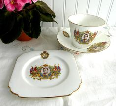 This is a King Edward VIII of England coronation cup and saucer with matching square plate or teacup trio made in 1937. The coronation never happened because th