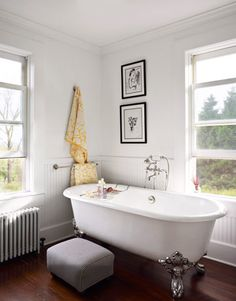 The finished renovation of this home resulted in this luxurious retreat, with a claw-foot tub by Kallista, clean white walls, and farmhouse style beadboard wainscoting. Old Houses, Country Bathroom Decor, Home, Bathroom Decor, Beautiful Bathrooms, Old Home Renovation, Cleaning White Walls, Farmhouse Renovation, Home Renovation