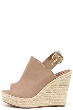 """Landlocked or lakeside, the Dockin' Out Blush Beige Peep Toe Espadrille Wedges know how to party! A beige vegan leather peep toe upper hugs your foot comfortably, and is paired with an espadrille-wrapped wedge that can be dressed up or down. Slingback adjusts with a gold buckle. 4.5"""" heel slides into a 1.25"""" toe platform. Cushioned insole. Nonskid rubber sole. Available in whole and half sizes. Measurements are for a size 6. All vegan friendly, man made materials. Imported."""