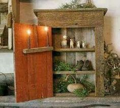 What a neat little grungy cabinet! And I love the sheep and the greens in it, but my favorite thing is the hanging candle holder -- SO rough and primitive with two glowing candles! Primitive Country Christmas, Antique Christmas, Primitive Christmas, Rustic Christmas, Primitive Furniture, Primitive Antiques, Primitive Crafts, Primitive Shelves, Country Crafts