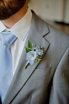 These light blue delphinium blooms make for perfect boutonnieres, Colorado summer wedding by La Rue Floral