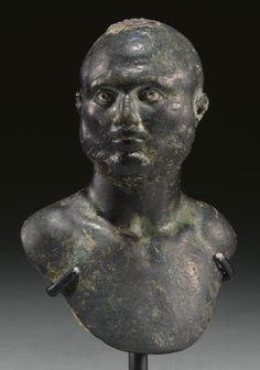 A ROMAN BRONZE STEELYARD WEIGHT,  CIRCA 2ND-3RD CENTURY A.D.