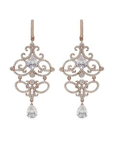 Rose Gold is the way to go! These dangle earrings have crystals that sparkle with life and gaiety in an open scroll design that trace and drop into pear shaped CZ stones $79.00 #davidtutera www.davidtuteraembellish.com