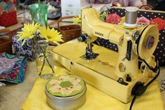 Love this gorgeous yellow sewing machine ... American Quilting retreat