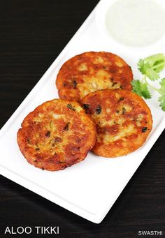Aloo tikki recipe with video & step by step photos – Simple spiced potato patties to enjoy as a snack. Aloo tikki is a popular Snack across India made using mashed potatoes, spice powders and other basic ingredients. There are two ways aloo tikki is made, Diwali Special Recipes, Ramadan Recipes, Sweets Recipes, Indian Food Recipes, Vegetarian Recipes, Snack Recipes, Amish Recipes, Dutch Recipes, Indian Snacks