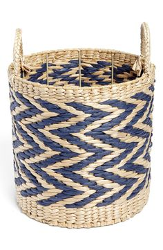 A modern chevron-print lends elegant, geometric sophistication to a straw basket perfect for storing magazines, papers or other small goods.
