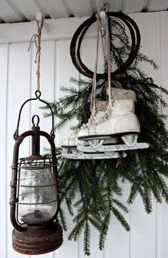 Christmas decor with skates, greens, and lantern