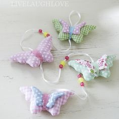 Pretty hanging padded fabric butterfly garland hanging from white satin ribbon with little coloured glass beads. Very long at H81cm W9.5cm D2.5cm.  £9.95