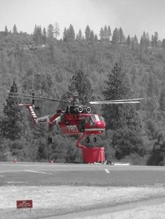 Helicopters dropping fire retardant nearly non-stop